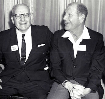 Frank Hyde chats it up with Chicago White Sox owner Bill Veeck at the Temple Hesed Abraham Sports Night at the Hotel Jamestown in 1965