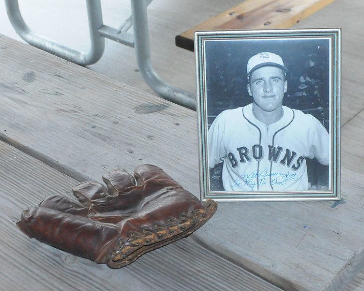 photo of Walt Brown on picnic table beside his baseball glove