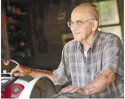 Moore, who died in May 2008, sits on his tractor.