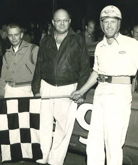 Left to right, mechanic Jim Fardink, owner Julian Buesink, and driver Freddy Knapp after a win at Stateline on July 30, 1966.