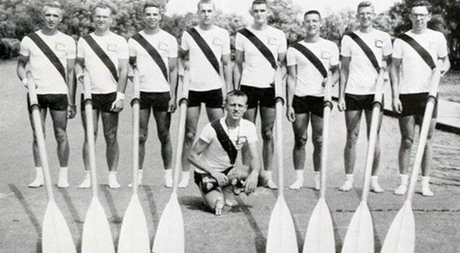 Phil Gravink, far left, stands with the 1957 Cornell University crew, holding the oar that was donated to the CSHOF.