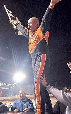 Dick Barton celebrates his victory.