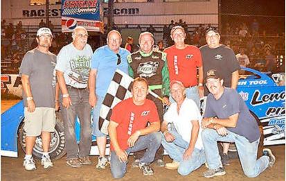 With his Super Late Model performance Saturday night, Dick Barton tied Bob Schnars for most career wins at Stateline Speedway with 79. After the victory, Barton, standing third from right, is joined by his race team. Kneeling, from the left, are Charlie Lacki, Greg Farrar and Keith Carlson. Standing, from the left, are Doug Wood, John Lamb, Del Seekings, Barton, Randy Anderson and Ryan Seekings.
