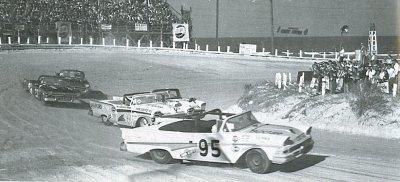 Fireball Roberts at the NASCAR Convertible race at Daytona road/beach course, 1958.