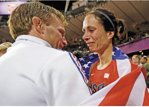 Jenn Suhr and her husband Rick after winning the gold medal.
