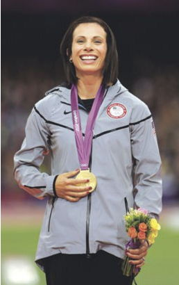 Fredonia native Jennifer Suhr poses with her gold medal for the women's pole vault in the Olympic Stadium at the 2012 Summer Olympics in London.