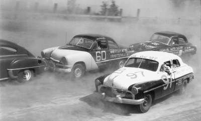 Jim Paschal driving Buesink's 1950 Ford #60 at a race in Macon, Georgia where he finished third.