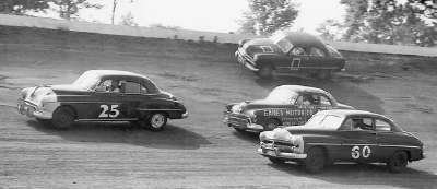 George Hartley in the #60 1950 Mercury in NASCAR action at Dayton, OH Speedway. #25 is Dick Linder. The car next to George Hartley is the great Curtis Turner.