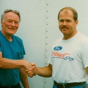 Bobby Schnars shakes Dick Barton's hand.