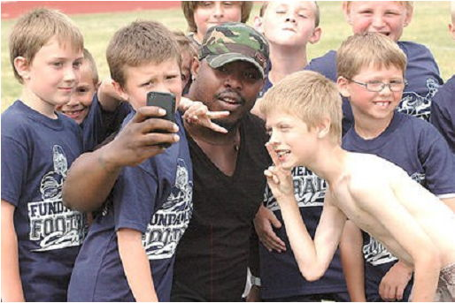 Clymer Central School and Michigan State University graduate Jehuu Caulcrick is pictured at a youth football camp in 2011.