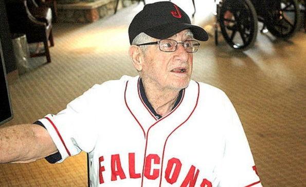 John O'Neil displays a throwback uniform top and cap.
