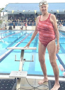 Judy Young next to her starting block at the YMCA Masters National Swimming Championships in Sarasota, FL.