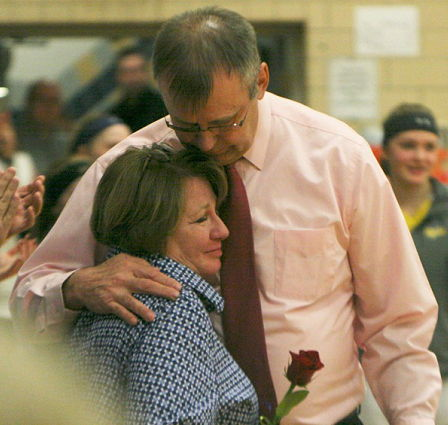Sherman coach Mel Swanson hugs his wife, Mary.