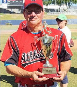 Charlie LaDuca holds the Men's Senior Baseball League World Series championship trophy.