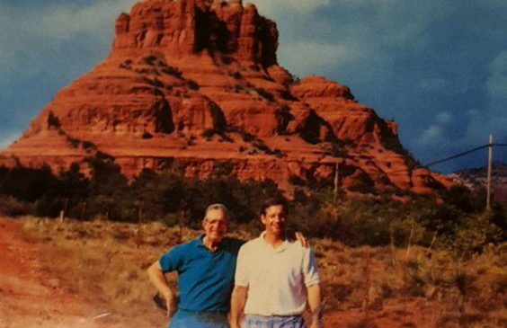 During a trip to the Men's Senior Baseball League World Series in 1994, Charlie LaDuca, right, and his father, Sam, pose for a photograph at Bell Rock in Sedona, Arizona.