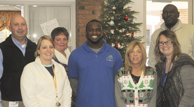 Members of the Employee of the Month Team at G.A. Family Services congratulate Maceo Wofford.