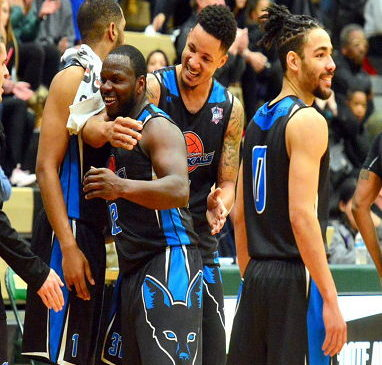 Jamestown's Maceo Wofford is congratulated by teammates after leaving the game Sunday evening.