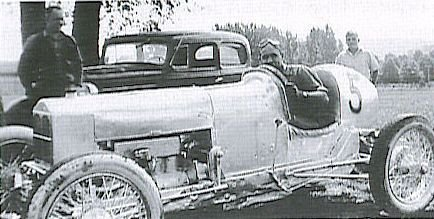 Lloyd Moore in his race car.