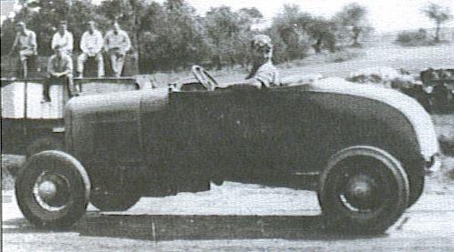 Lloyd Moore in race car.