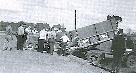 Lloyd Moore unloading race car.