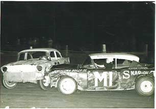 Jug Pierce and Bob Schnars collide on track.
