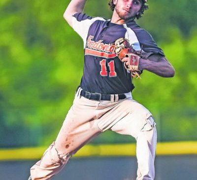 Jarod Burmaster pitching.