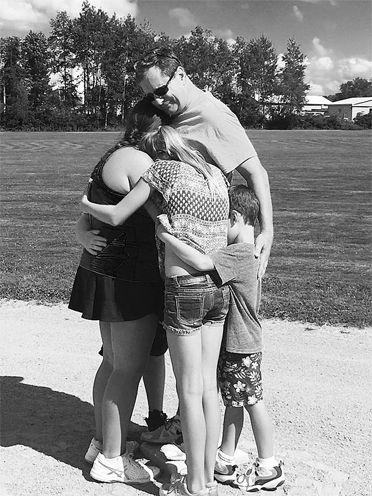Olsen family embrace.
