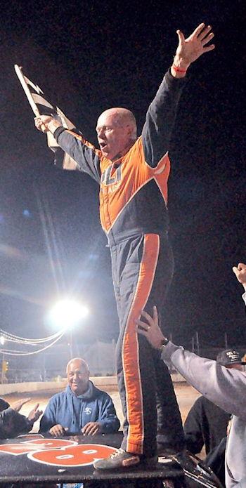 Dick Barton celebrates his record-setting 80th career victory.