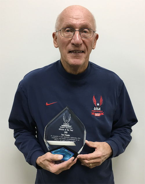 Tom Priester holds the trophy he was presented upon being selected the USA Track & Field Niagara Association Official of the Year.