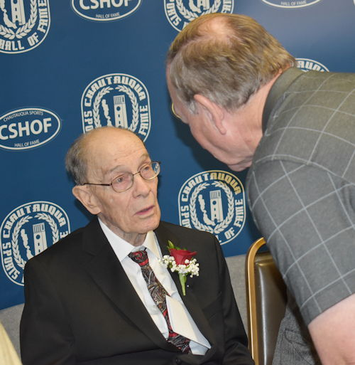 Dave Kolstee, right, speaks to longtime Southern Tier official Elly Norton.