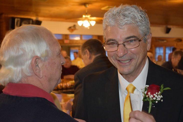 Bob Wisniewski, left, speaks to 2020 inductee Mark Orlando