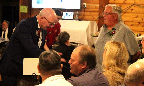 Randy Anderson, CSHOF president, and 2020 inductee Bob Goold mingle