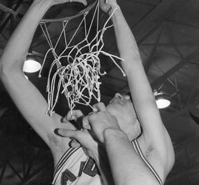 Mike McElrath cuts down the nets.
