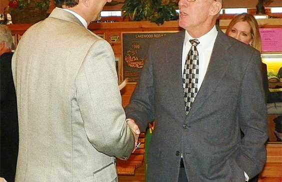 Dan Lunetta and Tom Priester shake hands.