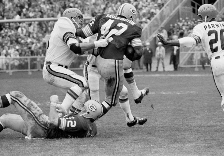 Bill Bergey hauls down John Brockington.
