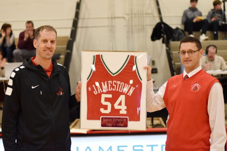 Justin Johnson's jersey is retired by Ben Drake.