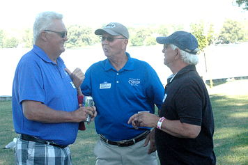 Chuck, Randy and Bob share a moment at the picnic.