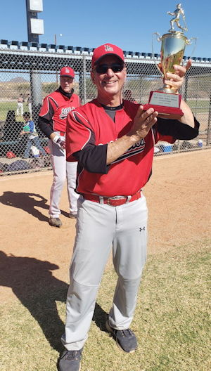 Charlie LaDuca poses with the championship trophy.