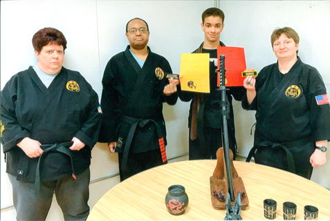 Malahki Schroder of Kebort's Karate Tigers, second from the right, recently was promoted to the rank of First Degree Blackbelt.