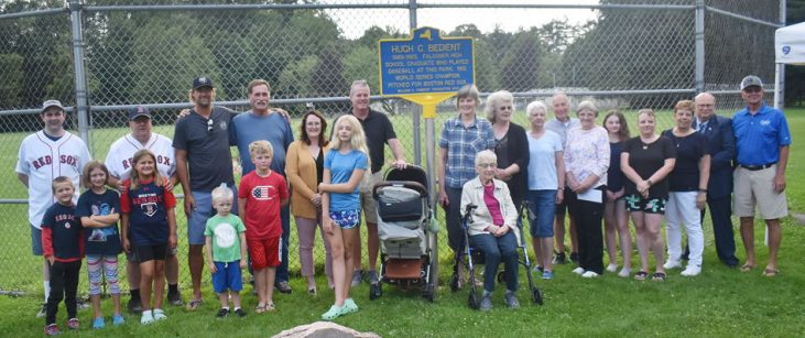 Bedient family members, village officials and friends pose for a photograph with the marker.