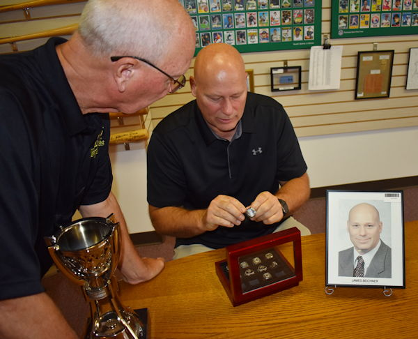 Jim Beichner with Randy Anderson looking at his rings.